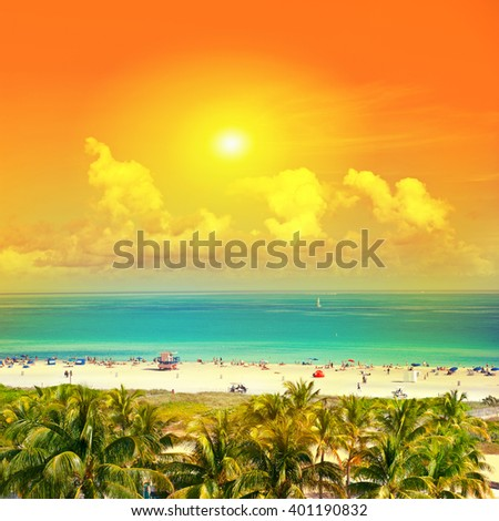Beautiful sunset. Landscape with blue sky, turquoise water and palm trees. Public beach in Miami Beach, Ocean Drive. Vintage style toned photo