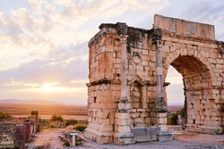 Beautiful sunset lanscape. The ancient antigue roman city Volubilis in Morocco, Africa.