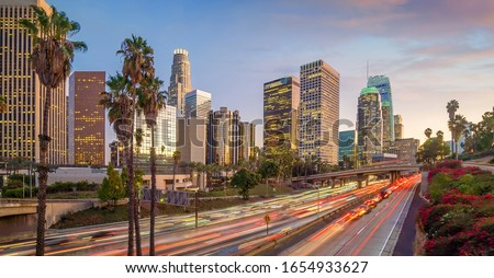 Beautiful sunset of Los Angeles downtown skyline in CA, USA Stock photo ©