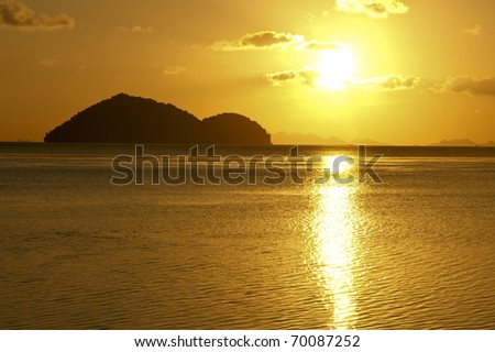 Beautiful sunset on a Thai beach, Ko Pha Ngan. - stock photo
