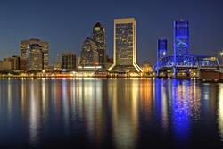 Beautiful sunset on St. John's River and Jacksonville, Florida skyline showing the John T. Alsop Jr. Bridge