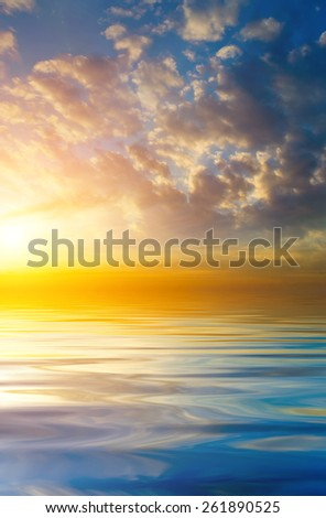 Beautiful sunset on the background of the calm sea. natural composition