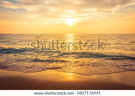 Beautiful sunset on the beach and sea - Vintage Filter #1007176441