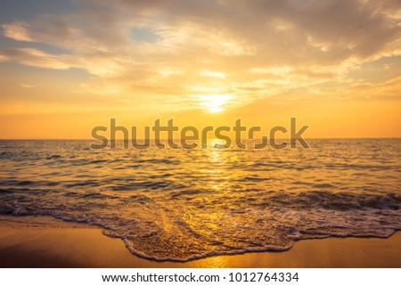 Beautiful sunset on the beach and sea - Vintage Filter #1012764334