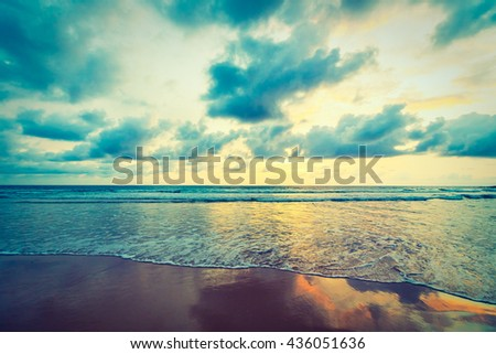 Beautiful sunset on the beach and sea with cloud and sky background - Vintage Filter #436051636