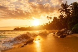 Beautiful sunset on the beach in a tropical resort in the Caribbean