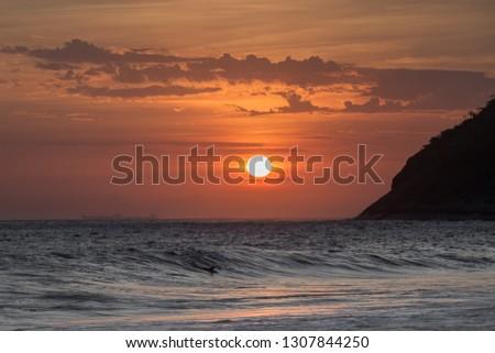 beautiful sunset on the beach of itacoatiara in niterói, rio de janeiro, brazil #1307844250