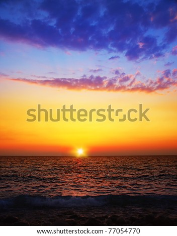 Beautiful sunset on the beach, seascape with calm water