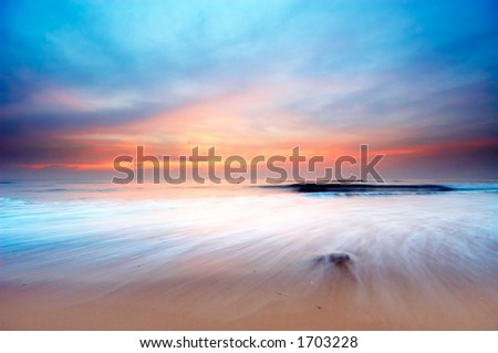 beautiful sunset on the beach (slow shutterspeed)