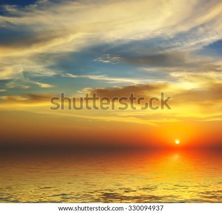 beautiful sunset on the sea #330094937