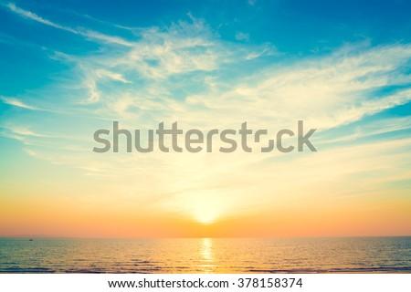 Beautiful sunset on the sea at twilight times - Vintage Filter #378158374