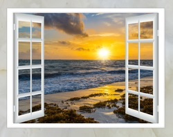 beautiful sunset on the sea view from the window with curtains open