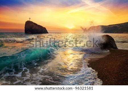 beautiful sunset on the sea with a wave