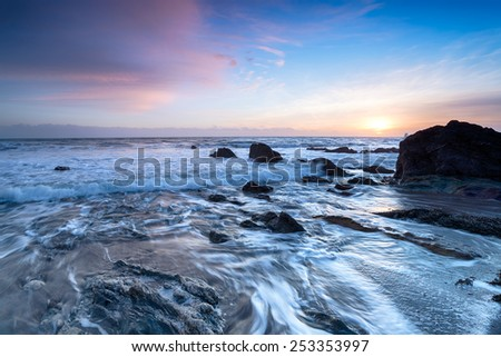 Beautiful sunset on the south coast of Cornwall at Portwrinkle on Whitsand Bay #253353997