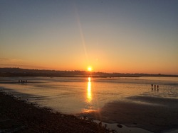 Beautiful Sunset on Vazon Bay, Guernsey, reflecting on the wet sand with an outgoing tide