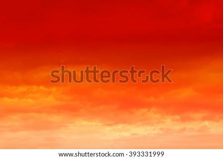 Beautiful sunset. Orange sunset sky with clouds.