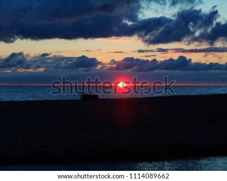 beautiful sunset over a body of water #1114089662