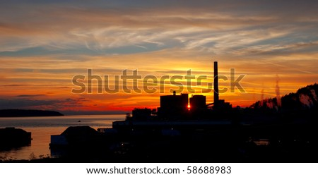 Beautiful sunset over a coastal lumber mill.