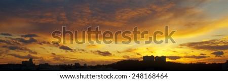 Beautiful sunset over a dark cityscape. #248168464