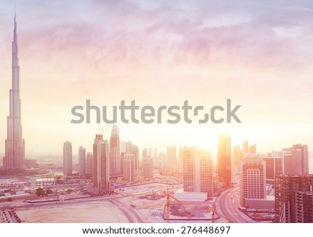 Beautiful sunset over Dubai city, amazing cityscape lit with warm sun light, contemporary new modern architecture, view from above on a luxury property of United Arab Emirates #276448697