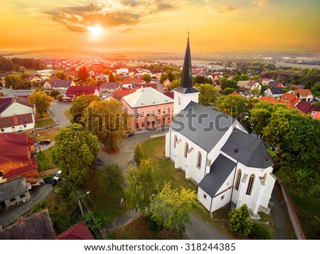 Beautiful sunset over gothic church St. Peter and Paul in The Litice suburb of Pilsen. Aerial view to romantic citiscape in Czech Republic, Central Europe. HDR (warm filtered) photography.  #318244385