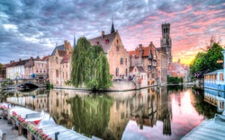 Beautiful sunset over Quay of the Rosary - Rozenhoedkaai, Bruges belfry tower and canal HDR wallpaper