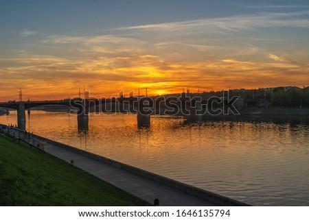 Beautiful sunset over the bridge over the Volga River