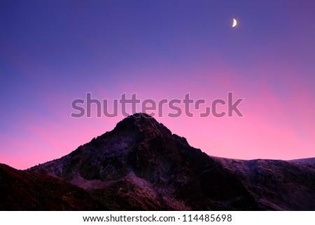 beautiful sunset over the high mountain peak