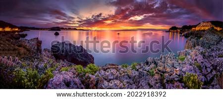 Beautiful sunset over the lagoon. Sea bay lagoon at sunset. Sunset sea bay lagoon panorama. Sunset sea bay panoramic landscape
