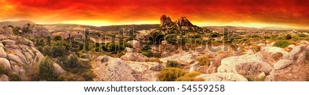 Beautiful sunset over the Moon Valley rock formations. Sardinia, Italy. Panoramic picture