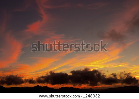 Beautiful sunset over the mountain - stock photo