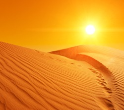 Beautiful sunset over the sand dunes in the Sahara desert, Tunisia