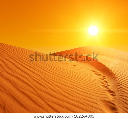 Beautiful sunset over the sand dunes in the Sahara desert, Tunisia - stock photo