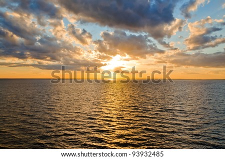 beautiful sunset over the smooth surface of a mountain lake