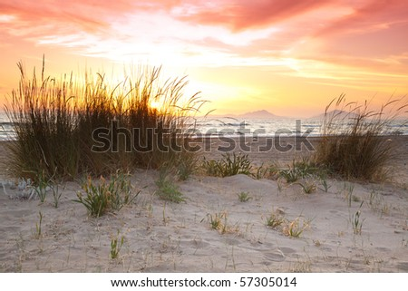 Beautiful sunset overlooking the Ionian Sea at the Kalogria Beach in Greece. - stock photo
