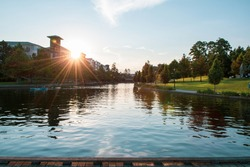 Beautiful sunset picture of the waterway in the Woodlands Texas, summertime leisure and fun