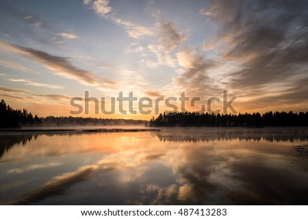Beautiful sunset reflected in the lake.