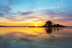 Beautiful sunset reflections over Sinepuxent Bay at Assateague Island in Maryland