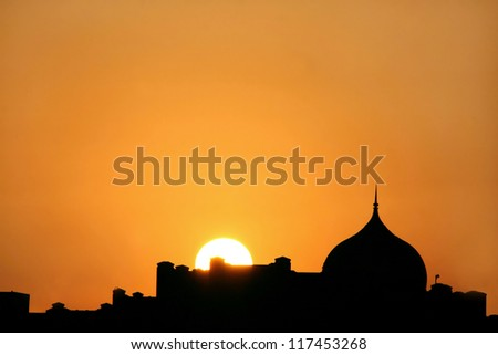 Beautiful sunset  silhouette of dome
