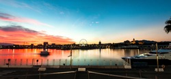 Beautiful sunset sky in the marina port in Malaga city. Panoramic view of the port of Malaga at sunset.
