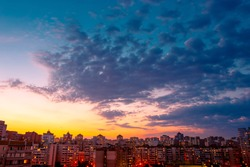 Beautiful sunset sky over city. Twilight over urban district. Aerial view. Typical modern residential area. Kyiv. Ukraine.