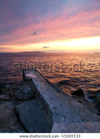 Beautiful sunset somewhere along the Adriatic coast, island Losinj, Croatia. - stock photo