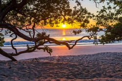 Beautiful sunset tropical beach with silhouette of trees for travel and vacation in holiday relax time. Playa Flamingo in Guanacaste, Costa Rica. Central America.