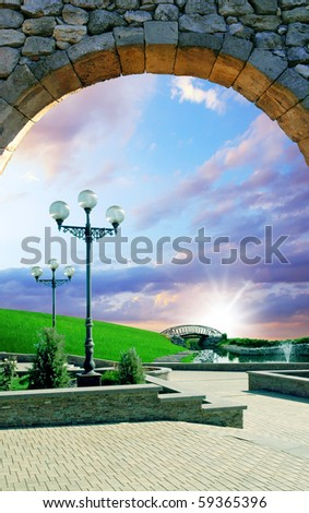 beautiful sunset under a arch