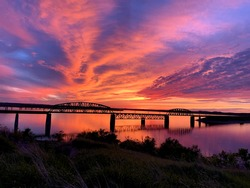 Beautiful sunset view in South Dakota with a bridge connecting over the Missouri River