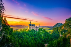 Beautiful sunset view of world-famous Neuschwanstein Castle, the nineteenth-century Romanesque Revival palace built for King Ludwig II on a rugged cliff near Fussen, southwest Bavaria, Germany