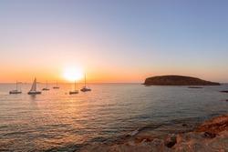 Beautiful sunset view on the island of Ibiza. View from the beach Cala Escondida (Cala Comte). Balearic Islands. Spain