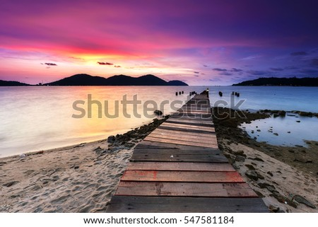 Beautiful sunset view with wooden jetty at Marina Island, Lumut Perak Malaysia. Nature composition. #547581184