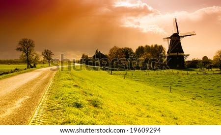 beautiful sunset windmill landscape in the netherlands