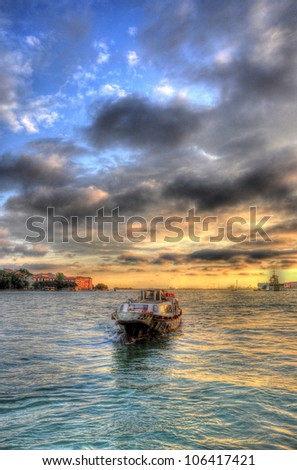 Beautiful sunset with a ship in the Mediterranean sea, Venice, Italy (HDR)